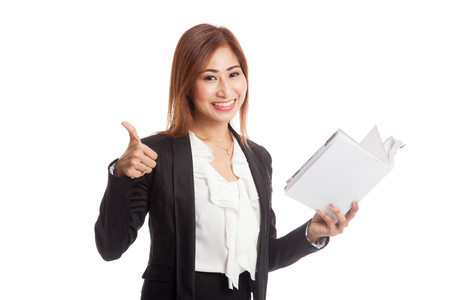 woman thumbs up: Young Asian business woman thumbs up with a book  isolated on white background Stock Photo