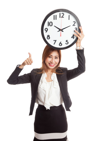 woman thumbs up: Young Asian business woman thumbs up with a clock  isolated on white background