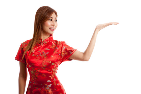 chipao: Asian girl in chinese cheongsam dress with  blank space on her hand  isolated on white background