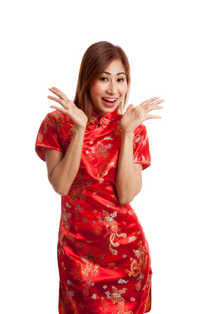 cheongsam: Excited Asian girl in chinese cheongsam dress on gray background