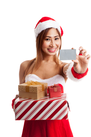 christmas debt: Asian Christmas girl with Santa clothes,  gift box and card  isolated on white background