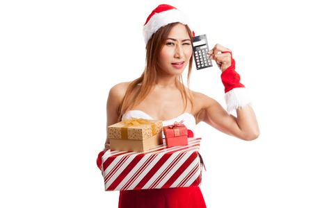 christmas debt: Asian Christmas girl with Santa  clothes and  gift box and calculator   isolated on white background