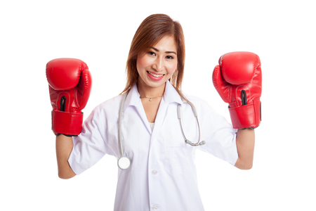 health care fight: Young Asian female doctor guard with boxing glove isolated on white background