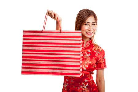 chipao: Asian girl in chinese cheongsam dress with shopping bag on gray background