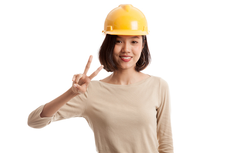 Asian engineer woman show Victory sign  isolated on white background 스톡 콘텐츠