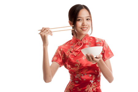 Asian girl in chinese cheongsam dress with  chopsticks   isolated on white background