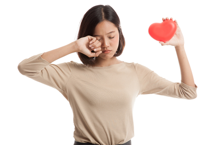 hydro power: Asian business woman sad and cry with red heart  isolated on white background