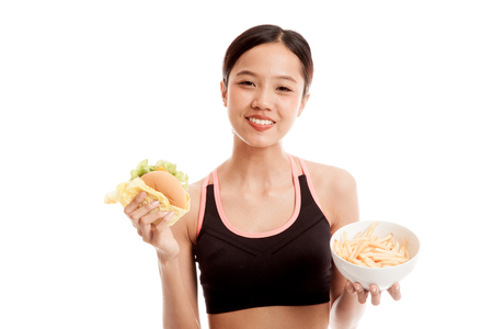 Beautiful Asian healthy girl with french fries and hamburger  isolated on white background