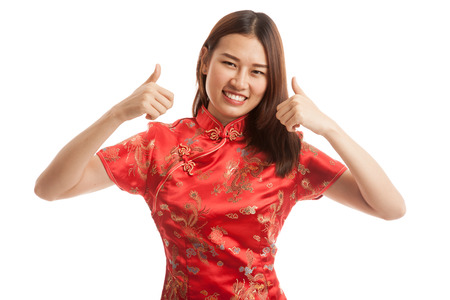 chipao: Asian girl in chinese cheongsam dress thumbs up   isolated on white background.