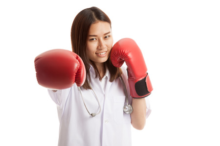 Young Asian female doctor punch with boxing glove   isolated on white background.