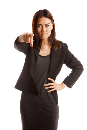 Young Asian business woman angry and point to camera  isolated on white background. Stock Photo