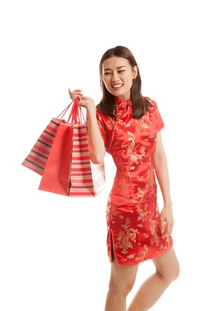 chipao: Asian girl in chinese cheongsam dress with shopping bag isolated on white background