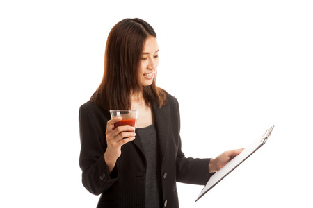 jot: Asian business woman with clipboard and  tomato juice  isolated on white background.