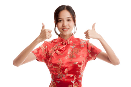 chipao: Asian girl in chinese cheongsam dress thumbs up   isolated on white background .