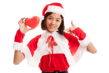 Asian Christmas Santa Claus girl point to red heart  isolated on white background .