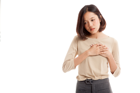 Young Asian woman got chest pain  isolated on white background .