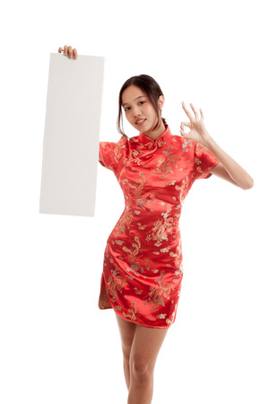 chipao: Asian girl in chinese cheongsam dress show OK with  blank sign isolated on white background .