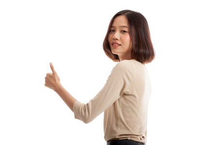 turn back: Young Asian businesswoman turn back thumbs up  isolated on white background .