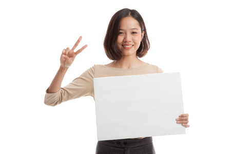 victory sign: Young Asian business woman show victory sign with blank sign  isolated on white background .
