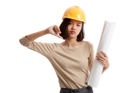 Asian engineer woman thumbs down with blueprints isolated on white background .