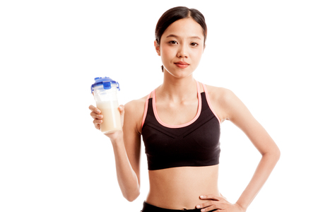 whey: Beautiful Asian healthy girl with whey protein  isolated on white background .