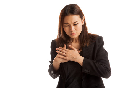 chest pain: Young Asian woman got chest pain  isolated on white background.