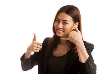 woman thumbs up: Young Asian woman thumbs up show with phone gesture  isolated on white background. Stock Photo