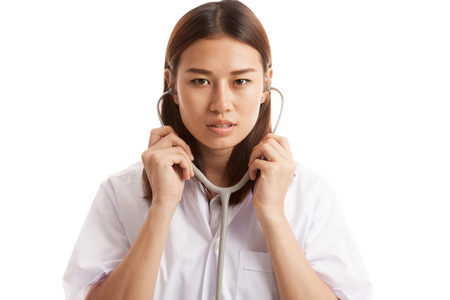 stethoscope: Asian young female doctor hold stethoscope  isolated on white background. Stock Photo