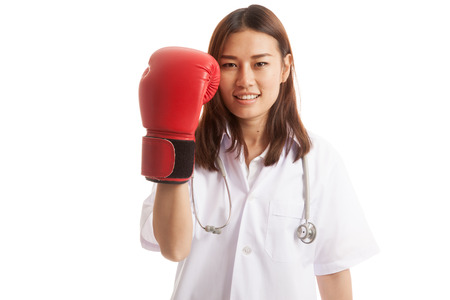 Young Asian female doctor with boxing glove   isolated on white background.