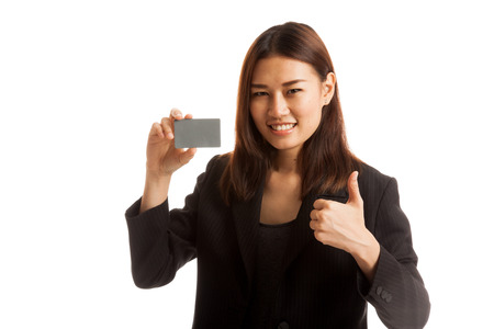 woman thumbs up: Young Asian business woman thumbs up with a blank card  isolated on white background. Stock Photo