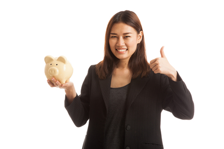 woman thumbs up: Asian business woman thumbs up with pig coin bank  isolated on white background.
