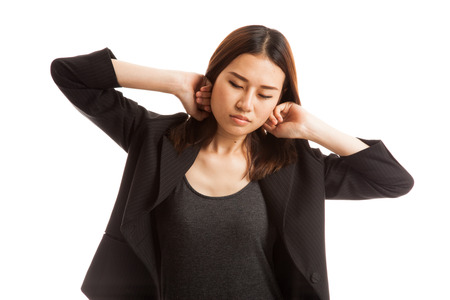 restless: Sleepy young Asian woman yawn  isolated on white background.