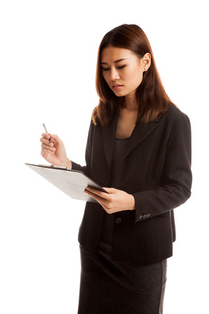 jot: Young Asian business woman with pen and clipboard  isolated on white background.