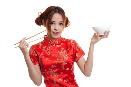 Asian girl in chinese cheongsam dress with  chopsticks   isolated on white background. Stock Photo