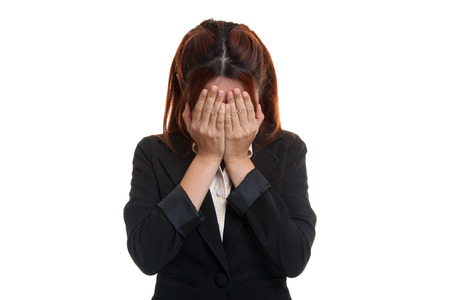mood moody: Sad young Asian businesswoman cry with palm to face  isolated on white background. Stock Photo