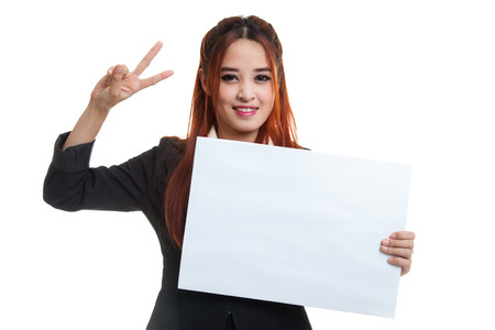 victory sign: Young Asian business woman show victory sign with blank sign  isolated on white background.