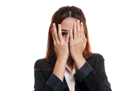 peeking: Beautiful young Asian woman peeking through fingers  isolated on white background.