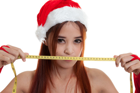 Asian Christmas Santa Claus girl diet with  measuring tape  isolated on white background.