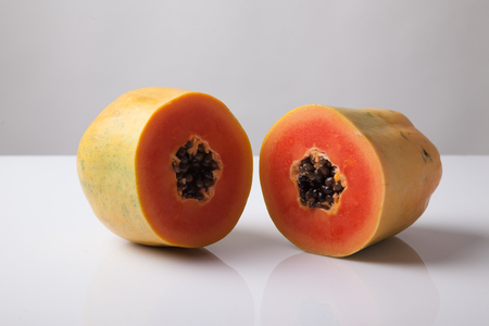 half  cut: Half cut ripe papaya  on white background