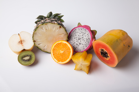 half  cut: Mix fruit in half cut on white background Stock Photo