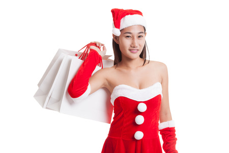 midnight: Asian Christmas Santa Claus girl with shopping bags isolated on white background. Stock Photo