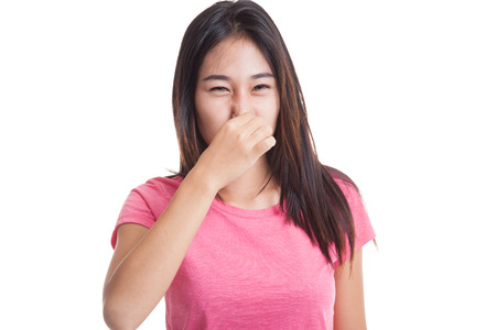 Young Asian woman  holding her nose because of a bad smell  isolated on white background.