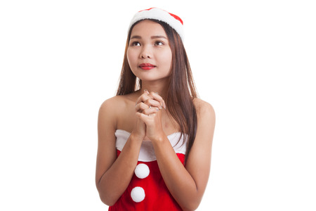 Asian Christmas Santa Claus girl  is praying  isolated on white background. Stock Photo
