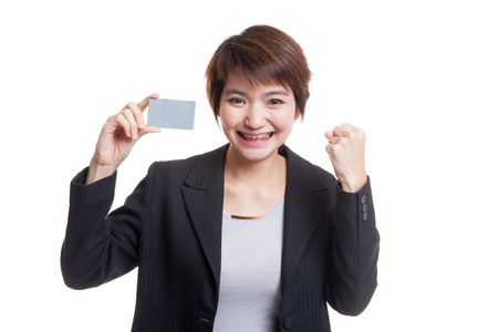 fist pump: Young Asian business woman fist pump with  blank card  isolated on white background. Stock Photo