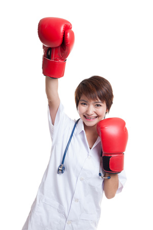 lady in red: Young Asian female doctor win the fight   isolated on white background. Stock Photo
