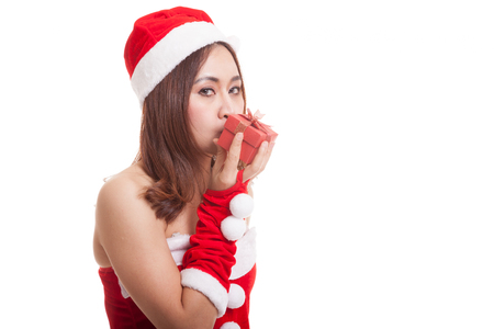 Asian Christmas Santa Claus girl  kiss a gift box  isolated on white background. Stock Photo
