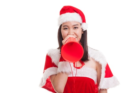 yell: Asian Christmas Santa Claus girl announce with megaphone isolated on white background. Stock Photo