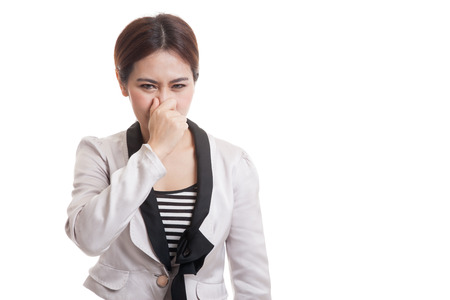 holding nose: Young Asian woman  holding her nose because of a bad smell  isolated on white background.