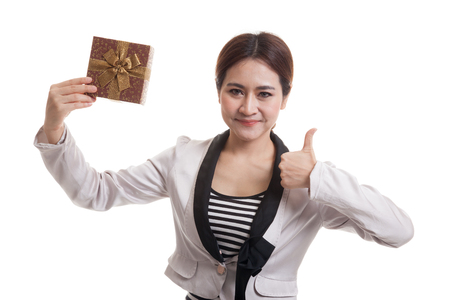woman thumbs up: Young Asian business woman thumbs up with a gift box  isolated on white background.