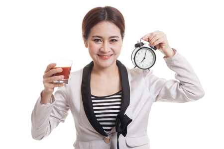 tomato juice: Young Asian business woman with tomato juice and clock  isolated on white background.